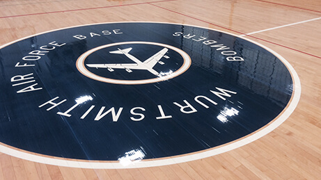 Sport Kote PC of Gym Floor with deep shine from Dark Blue Center Logo