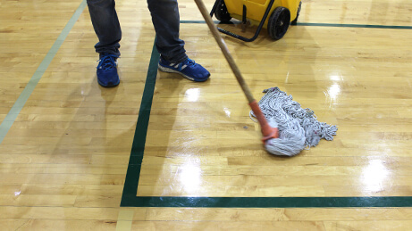Blue Concentrate Moping on a gym floor