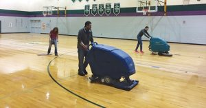 Using the Auto Scrubber on a Gym Floor