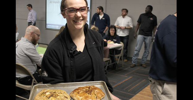 All Smiles at the Pot luck for Essential Industries