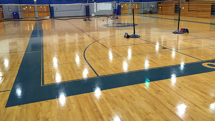 Sport Kote on a Gym Floor with a volley ball net up