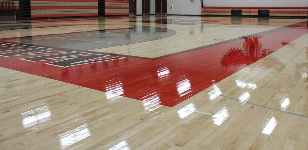 High Gloss Gym Floor with deep shine and reflection in red