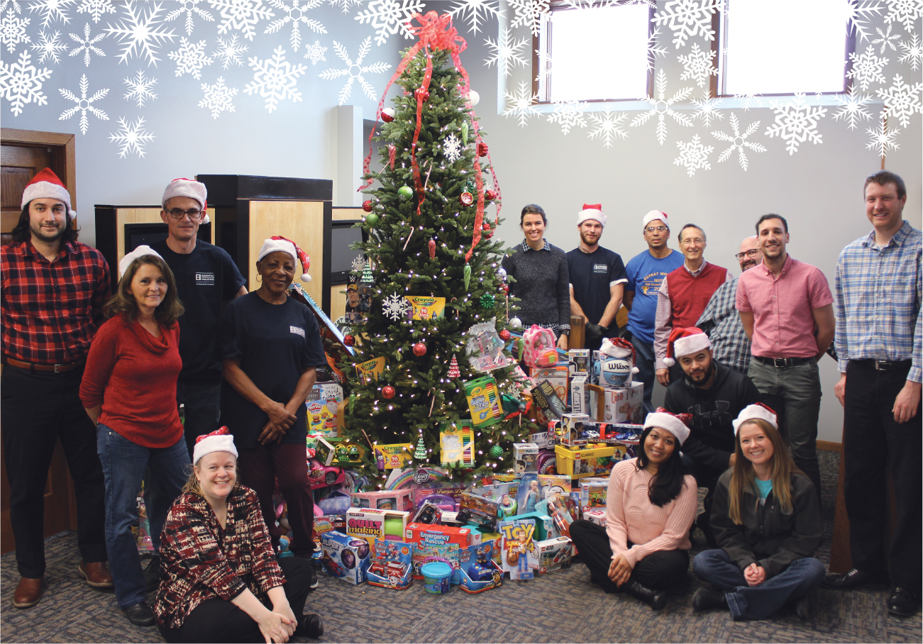 Essential employees and the toys that it donated to Toys for Tots