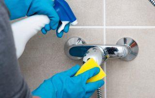 scrubbing a faucet